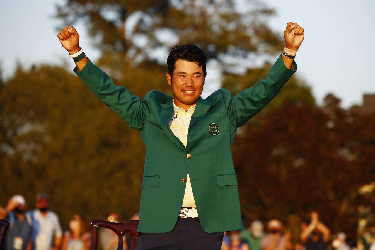 Hideki Matsuyama poses in the green jacket
