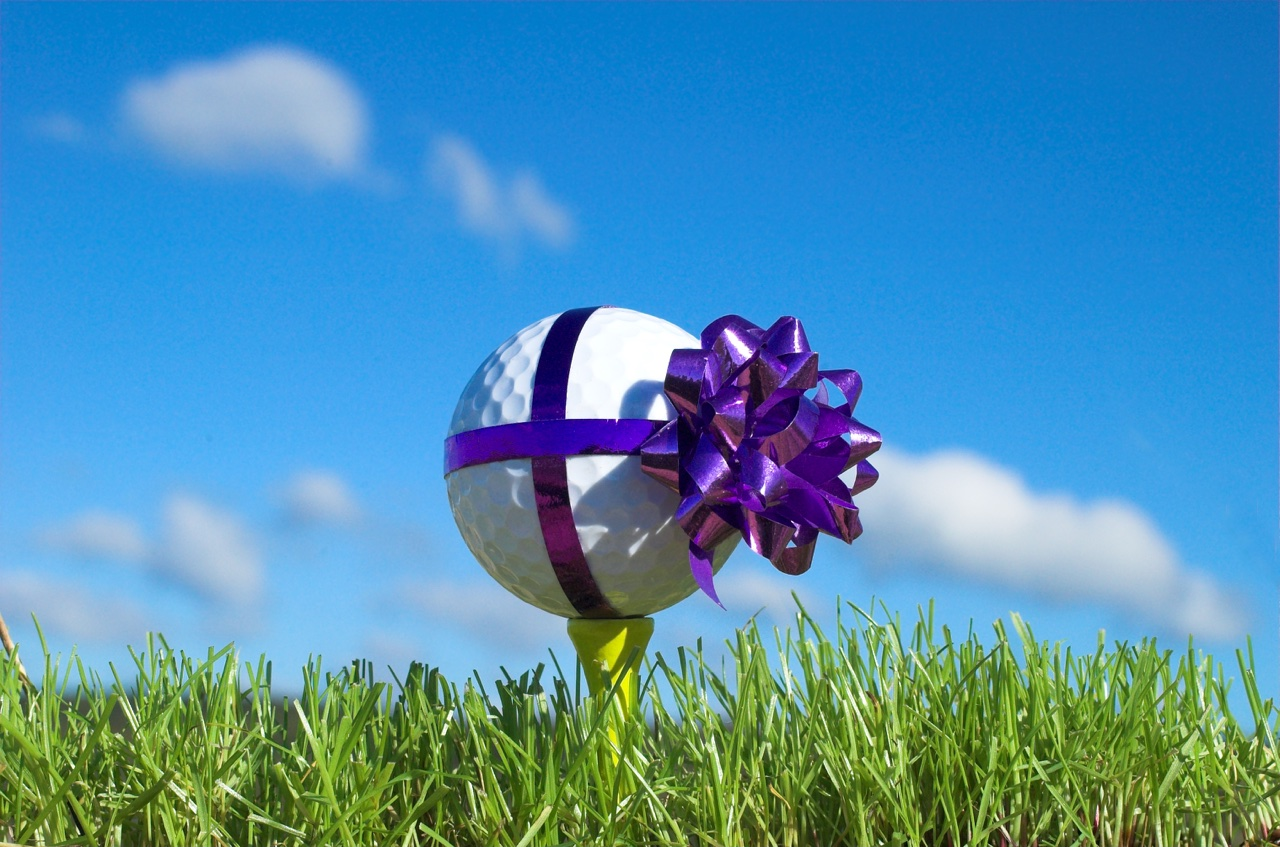 A golf ball wrapped with a bow