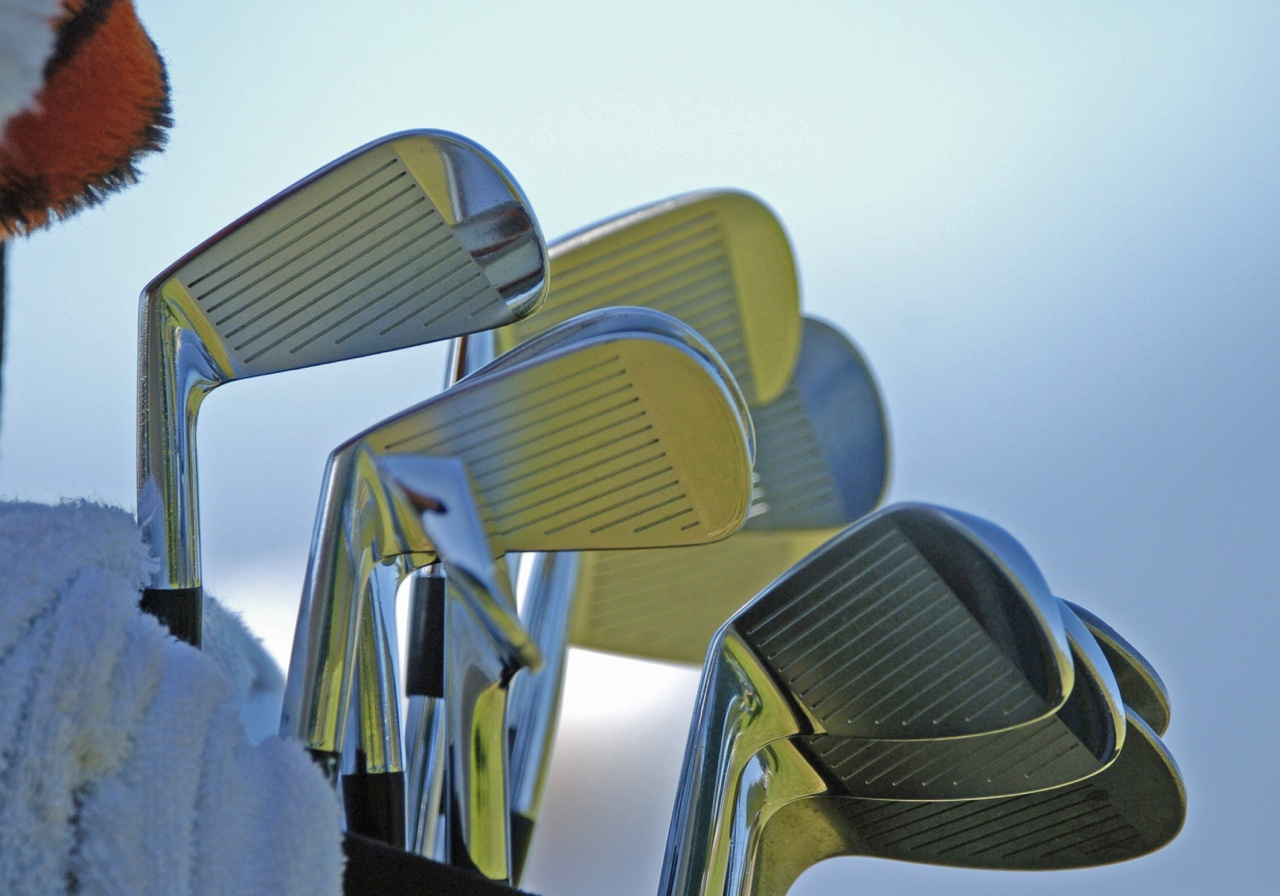 A set of irons in a golf bag