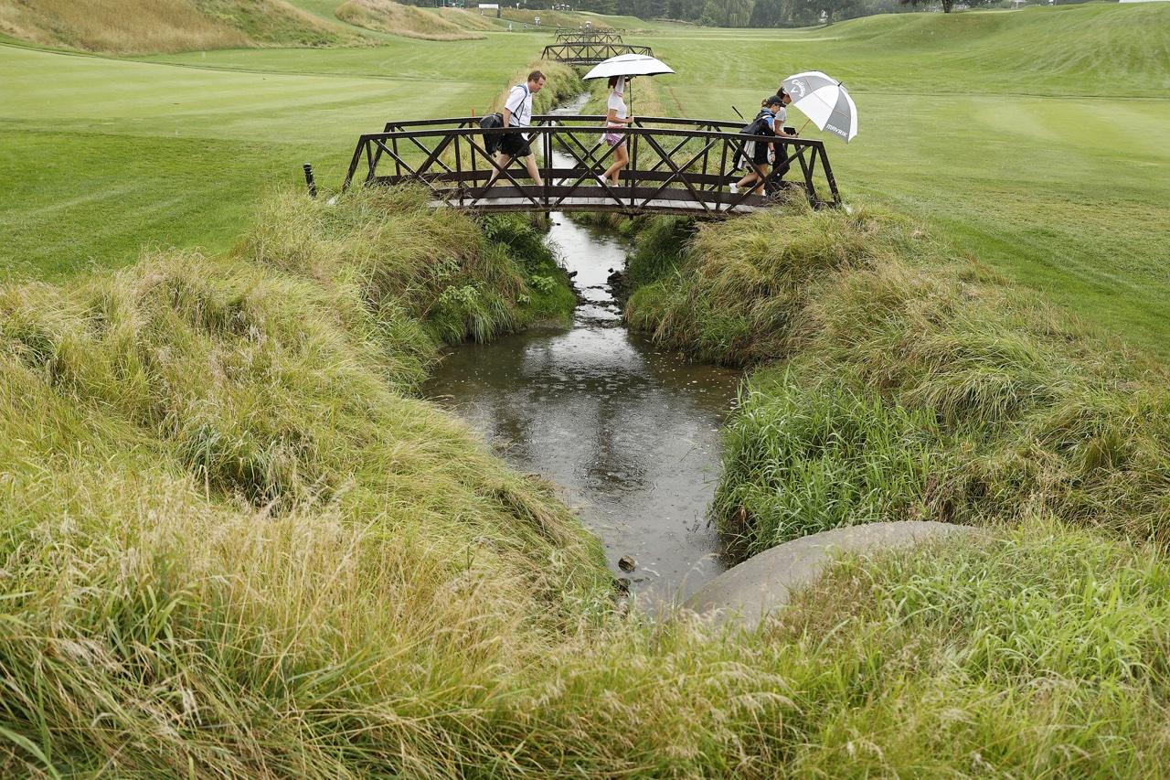 Players cross Inverness' 6th hole bridge