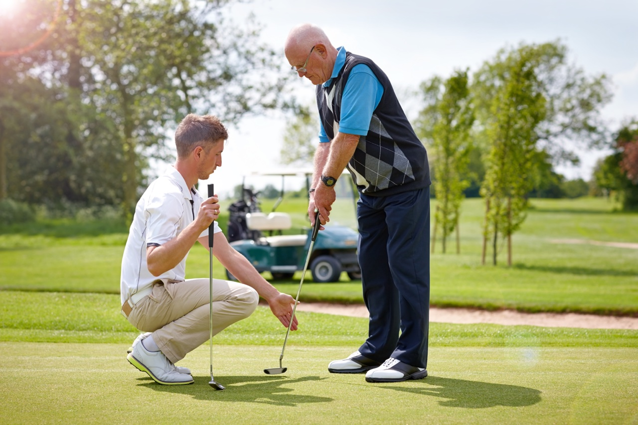 putting instructor works with a golfer