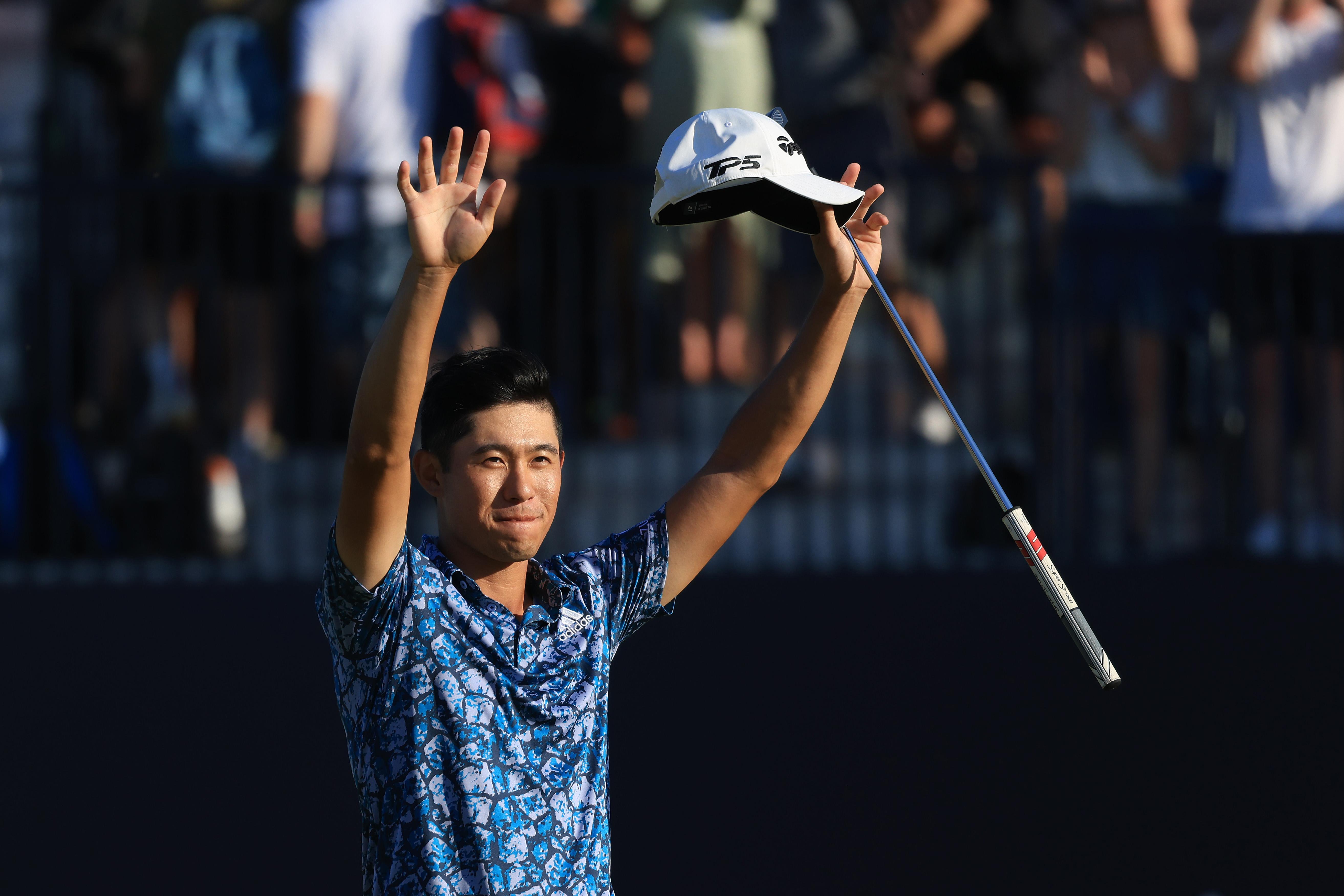 Collin Morikawa celebrates winning the Open