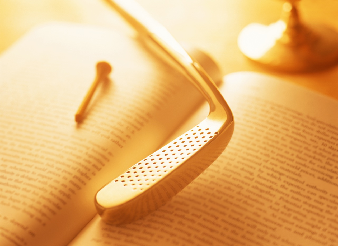 an open book and a golf club