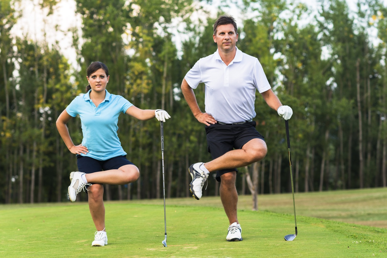 Two golfers stretch on the course