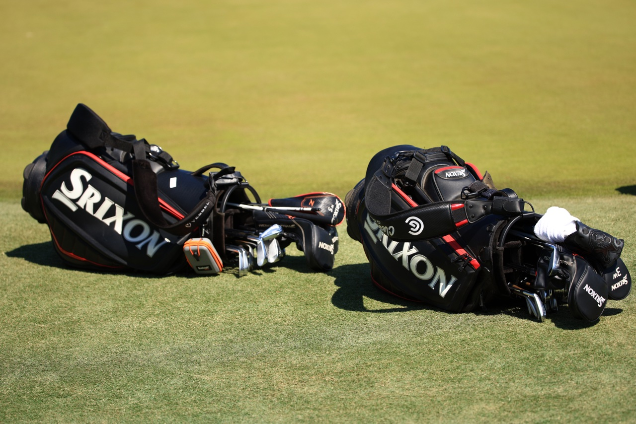 Two Srixon bags on the ground