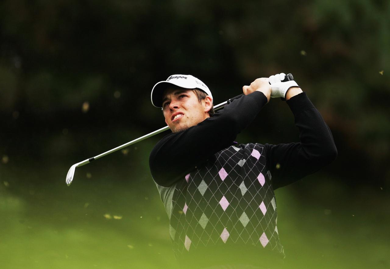 Aaron Baddeley hits a golf shot
