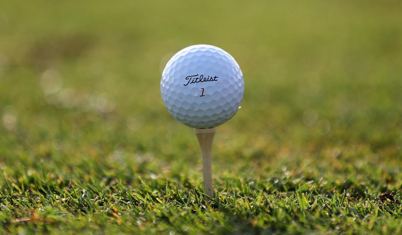 Titleist golf ball on a tee