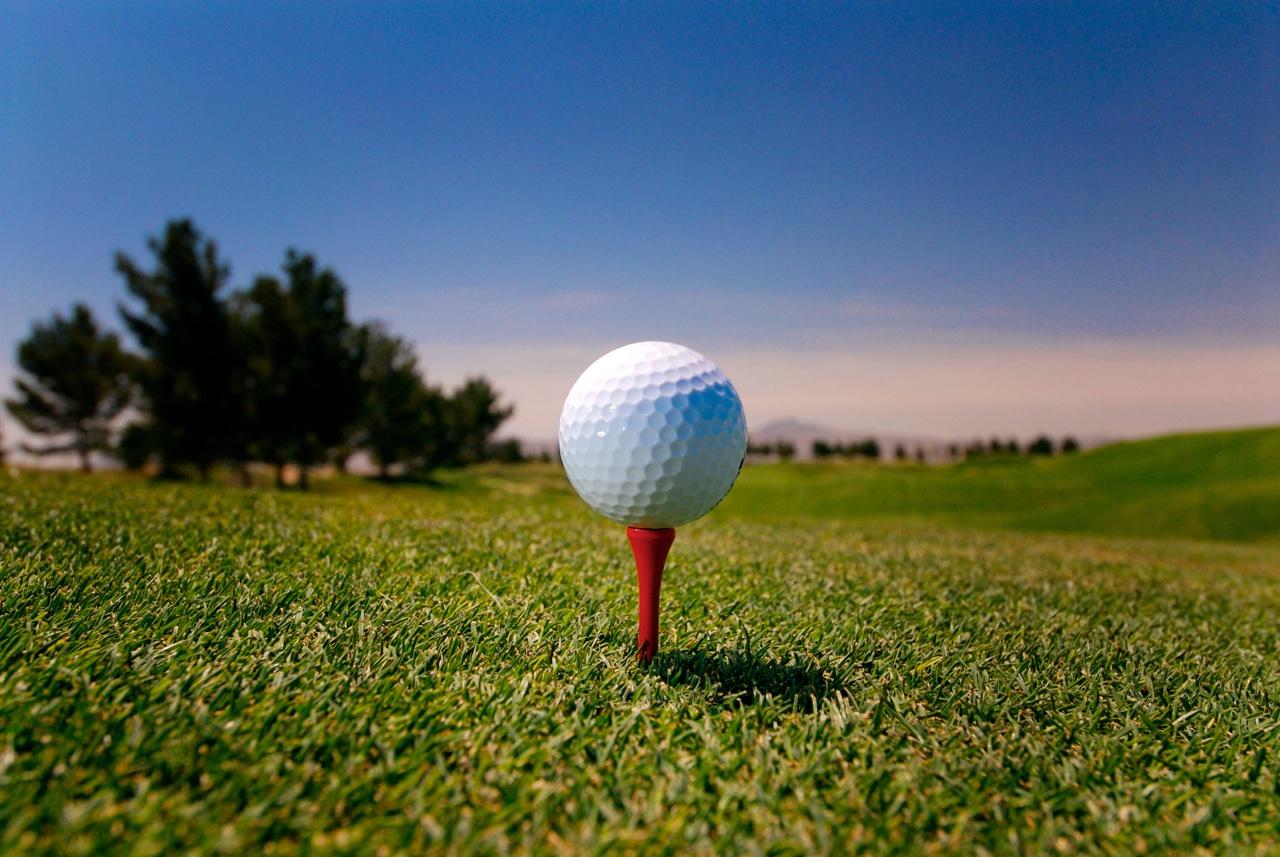 A golf ball sits on a tee